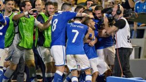 Jubilant scenes: The impressive Lorenzo Insigne is mobbed by teammates after opening the scoring.