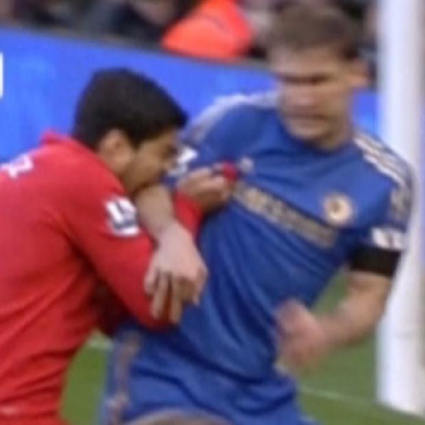 Ouch! Suarez getting stuck in.