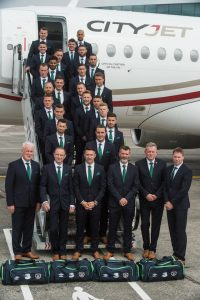 8 June 2016; The Republic of Ireland management, front row, from left, goalkeeping coach Seamus McDonagh, manager Martin O'Neill, captain Robbie Keane, assistant manager Roy Keane, coach Steve Walford and coach Steve Guppy, with squad members, from top, Shay Given, Darren Randolph, Robbie Brady, Keiren Westwood, Richard Keogh, Daryl Murphy, Cyrus Christie, Shane Duffy, Glenn Whelan, Stephen Ward, Ciaran Clark, Jeff Hendrick, David Meyler, Aiden McGeady, James McCarthy, Stephen Quinn, Jonathan Walters, Seamus Coleman, James McClean, Shane Long, Wes Hoolahan and John O'Shea board the CityJet flight to Paris for UEFA EURO2016 at Dublin Airport. CityJet is the official partner to the FAI. Photo by David Maher/Sportsfile *** NO REPRODUCTION FEE ***